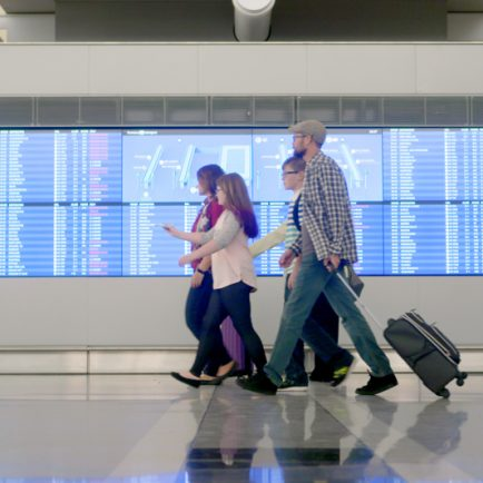 Family walking through airport