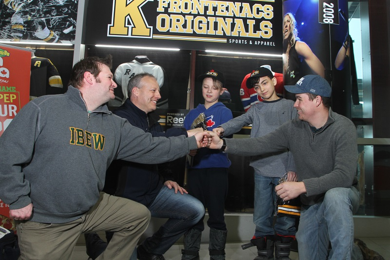 IBEW Local 115 fist bump with kids from Big Brothers Big Sisters Kingston