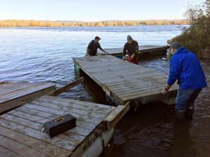 Volunteers working on dock