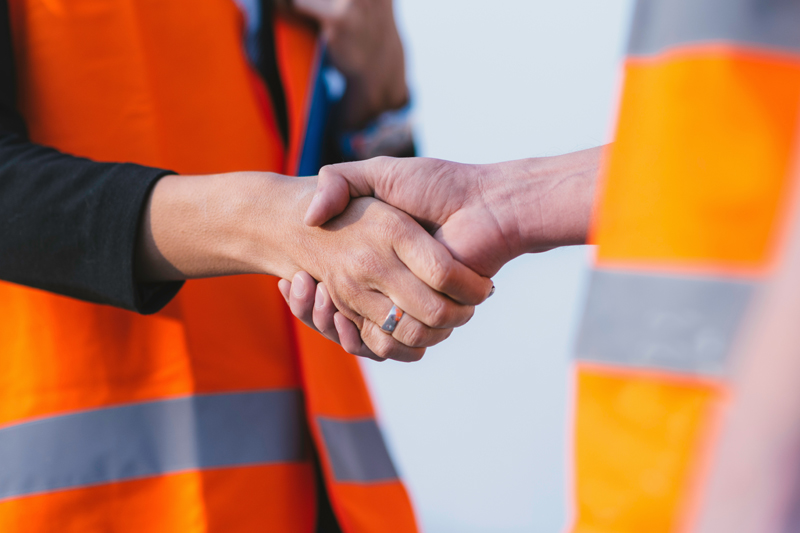 Construction workers handshake