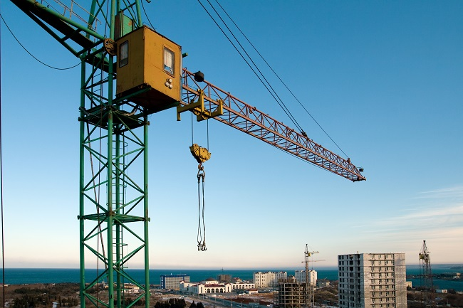 Construction crane over city